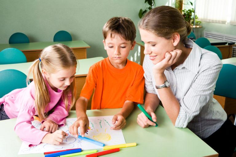 Teacher with kids in classroom