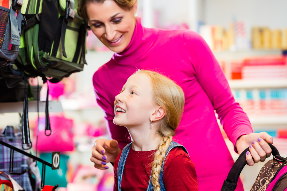 Mom and daughter shop for back to school backpack