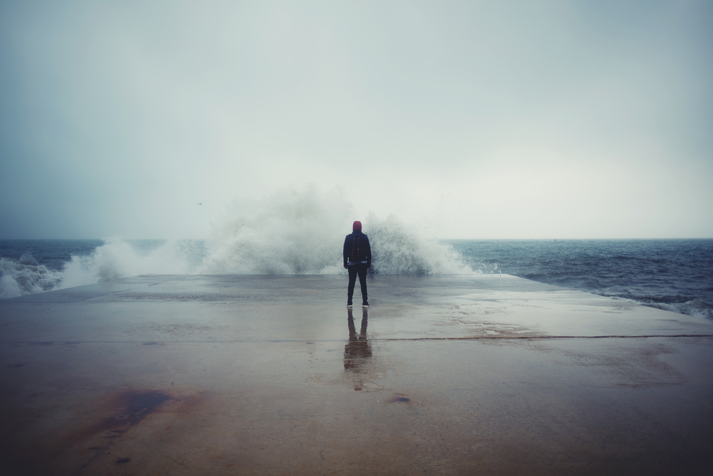 Person standing in front of wall of water