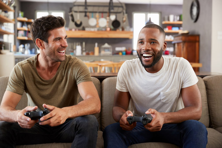 Two men who are best friends play video games