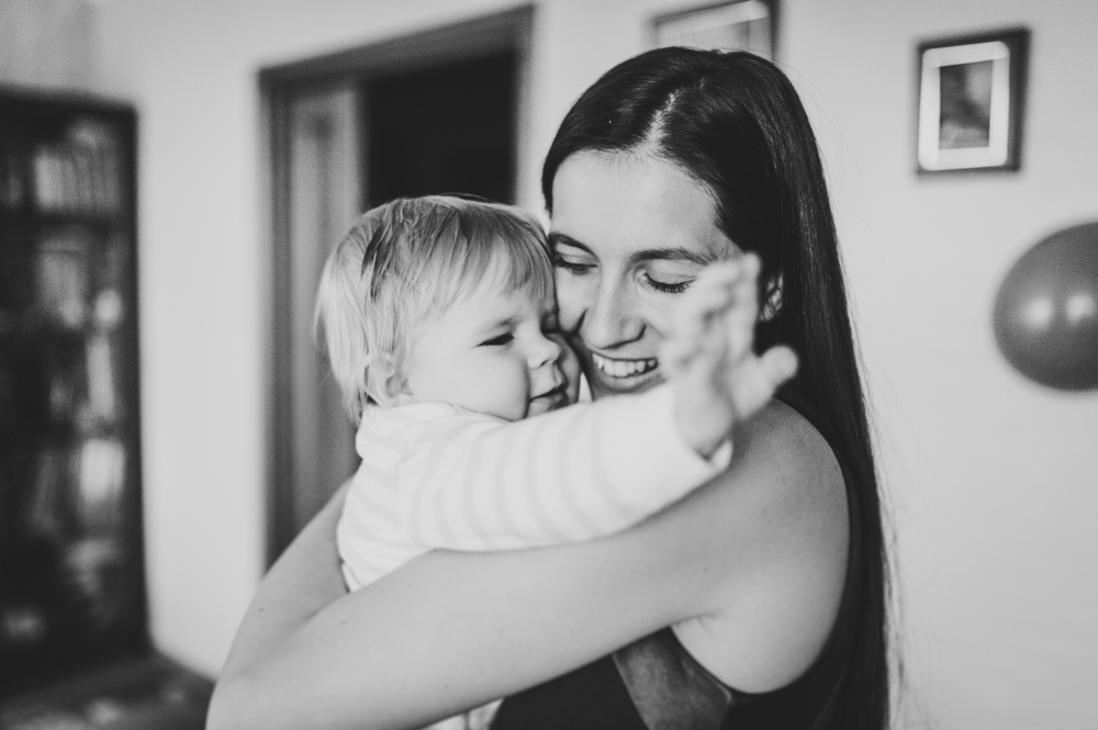 Black and white photo of mother and her young toddler laughing