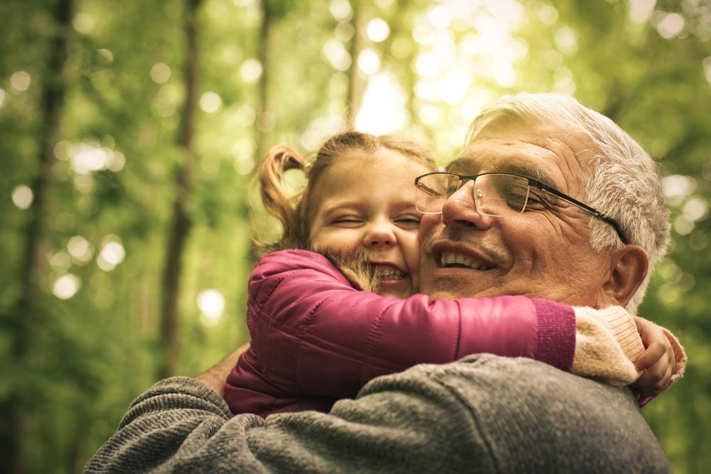 grandpa hugging grandchild