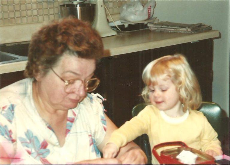 Grandma and grandchild at kitchen table