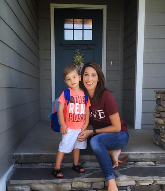 Mother and son on steps of home