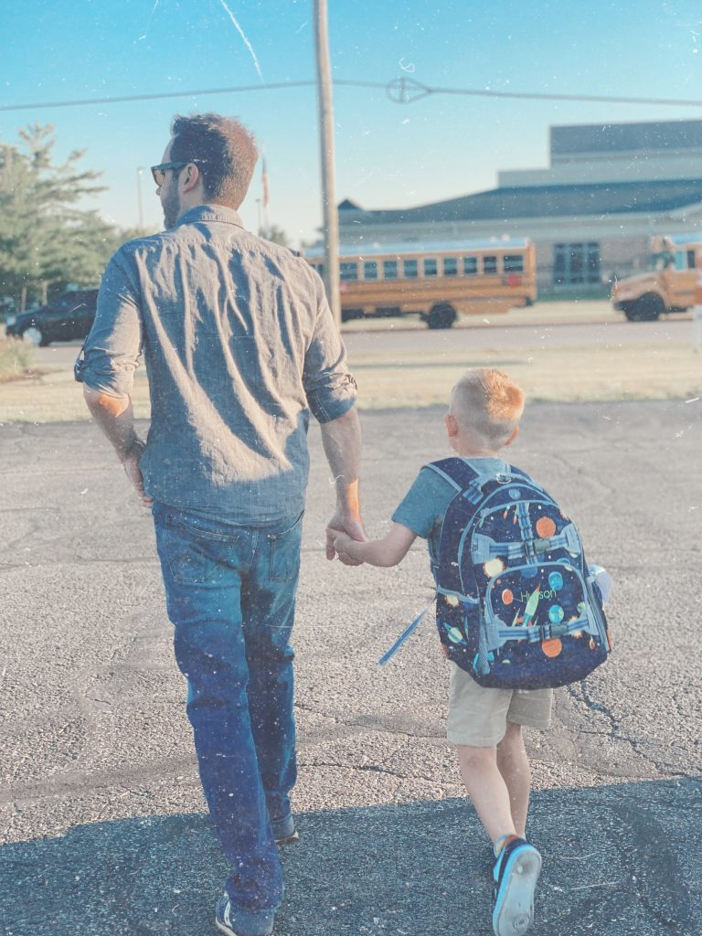 Little boy and father walk to school