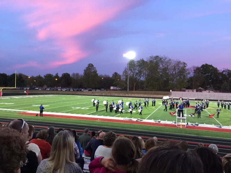 High school marching band at football game