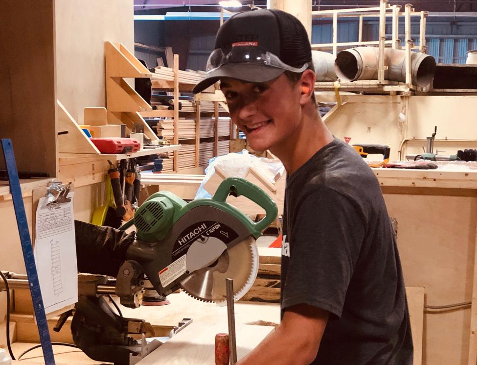 Teenage boy working in shop