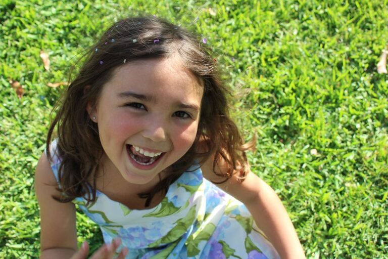Little girl laughing in the sun