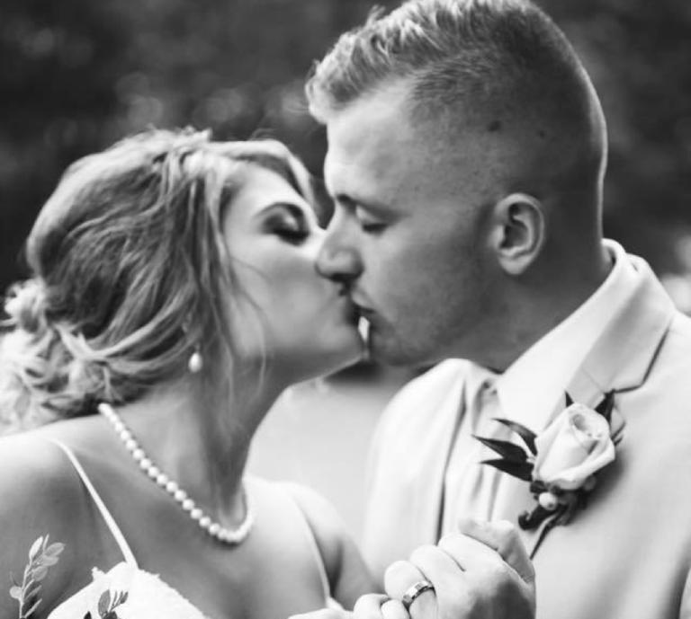 Husband and wife wedding photo kissing