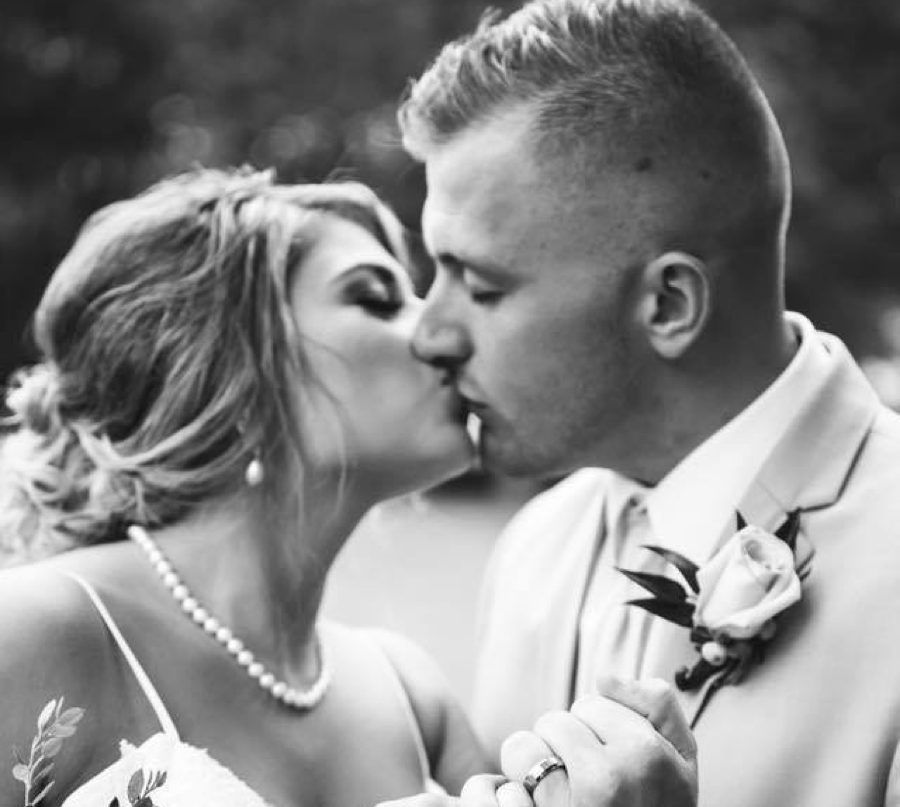 Husband and wife wedding photo kissing