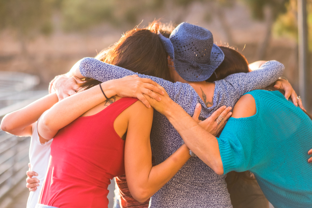 Group of women friends hugging