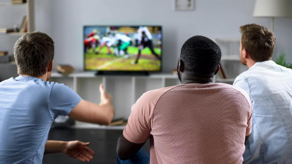 Men watching football game