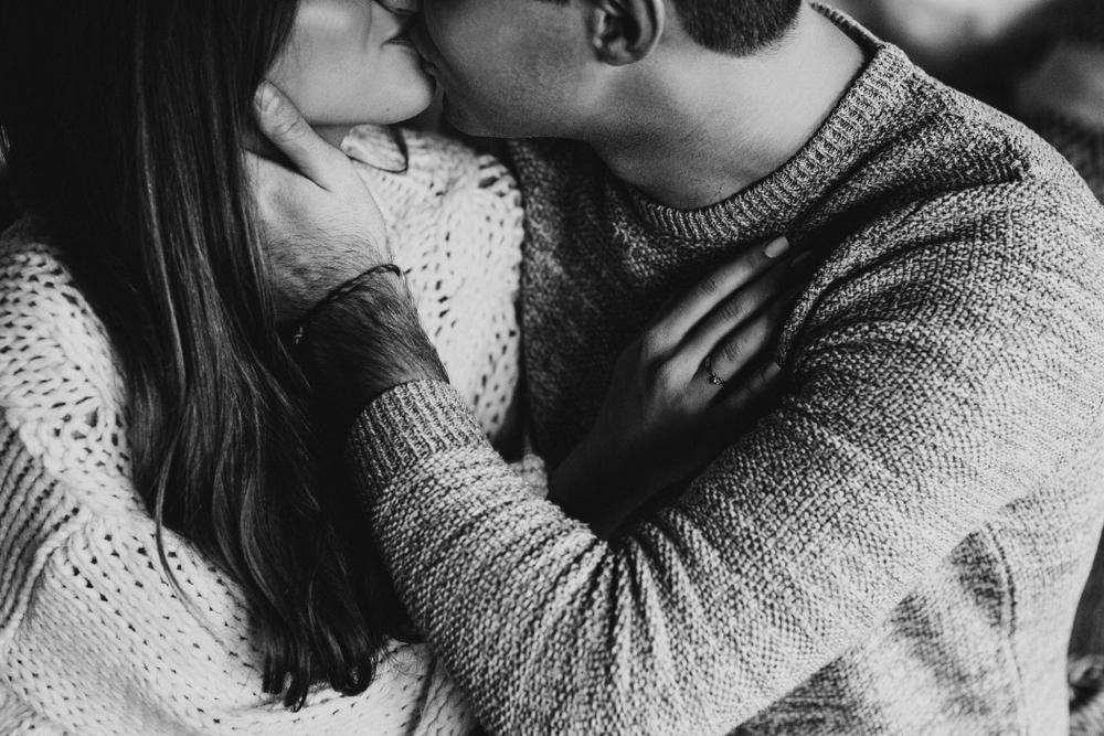 Husband kissing wife black and white photo