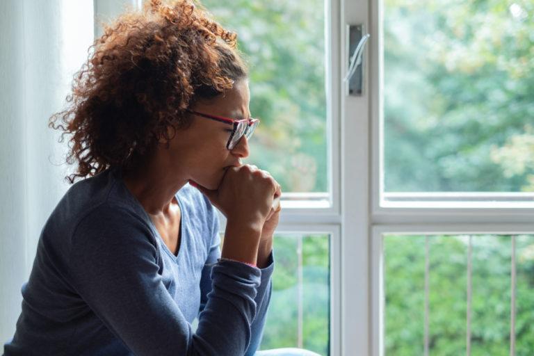 Sad woman by a window