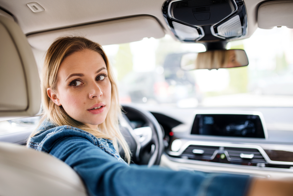 Exhausted mother driving car