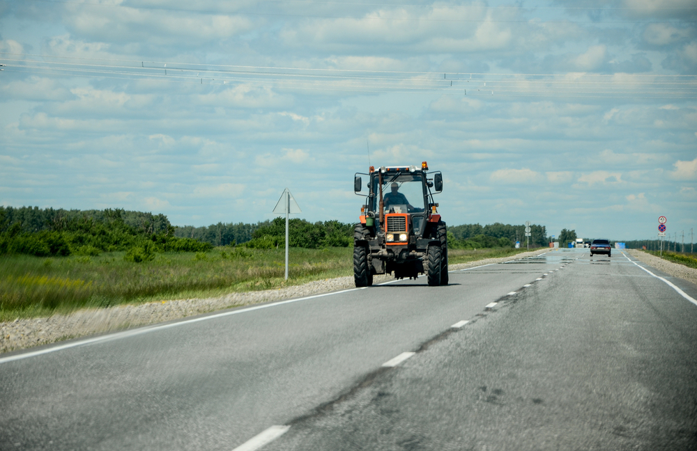 Tractor driving down the road