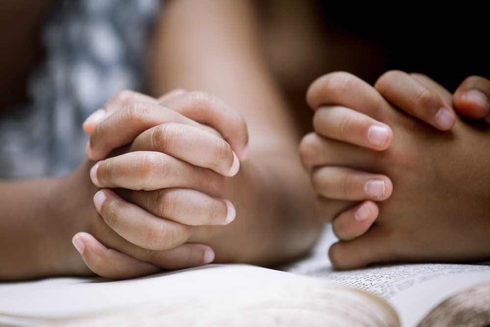 Folded hands praying