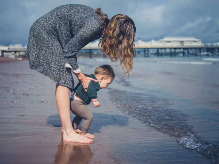 Mother with toddler on the beach