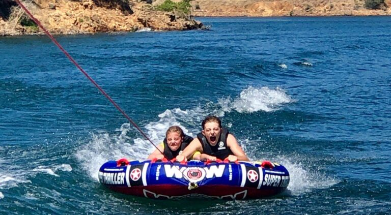 Kids on a tube on the lake