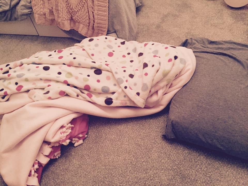 Blankets on bedroom floor