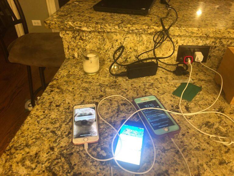 Smartphones on a kitchen counter