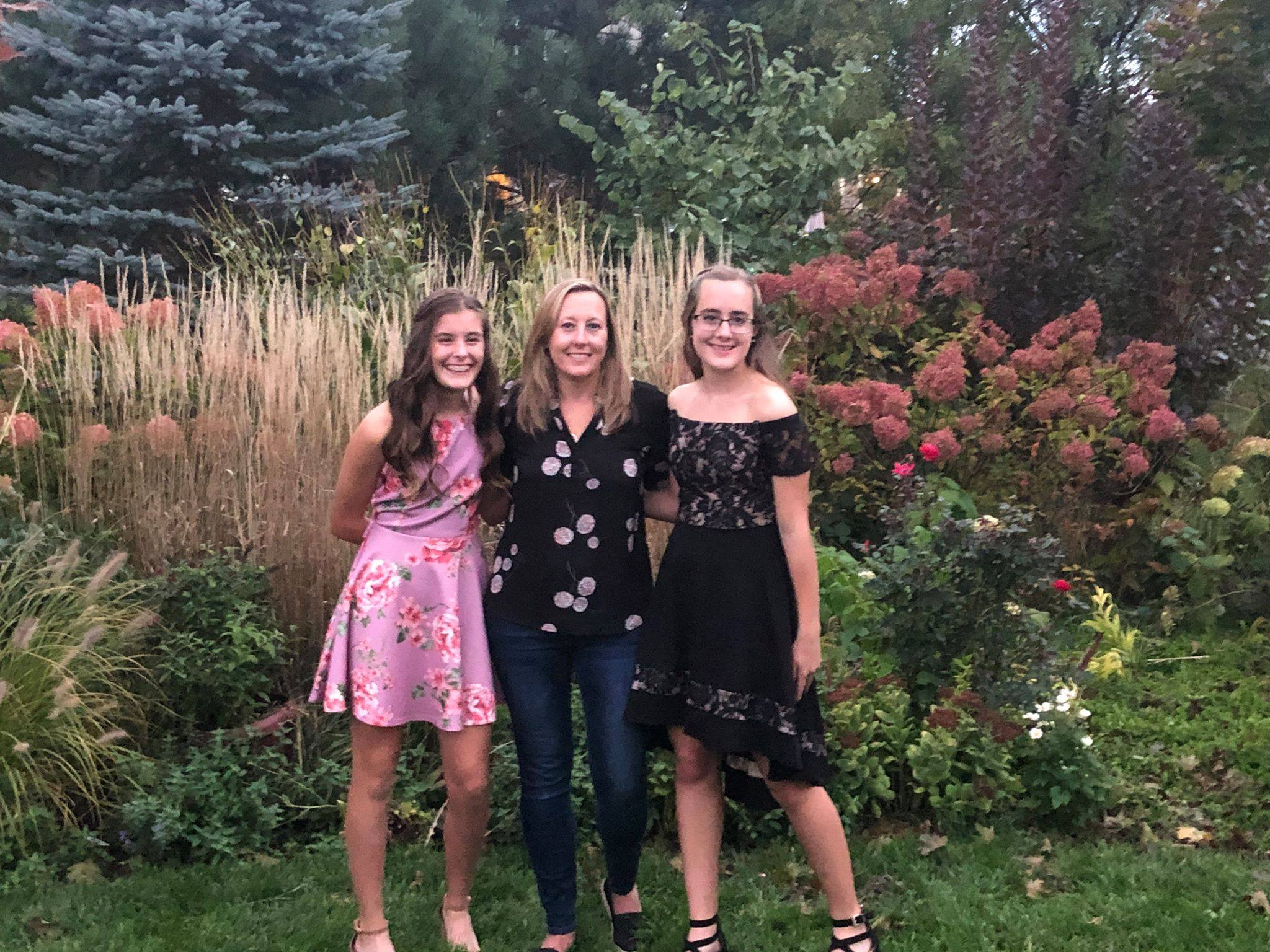 Mom and two teen daughters