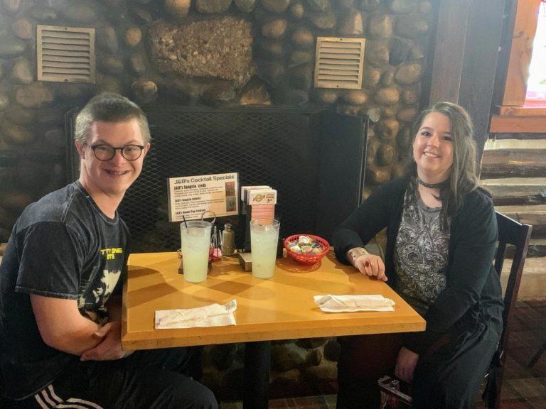 Two teens having dinner at restaurant