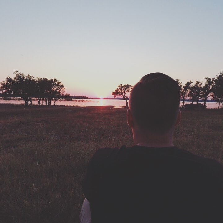 Person looking at sunset