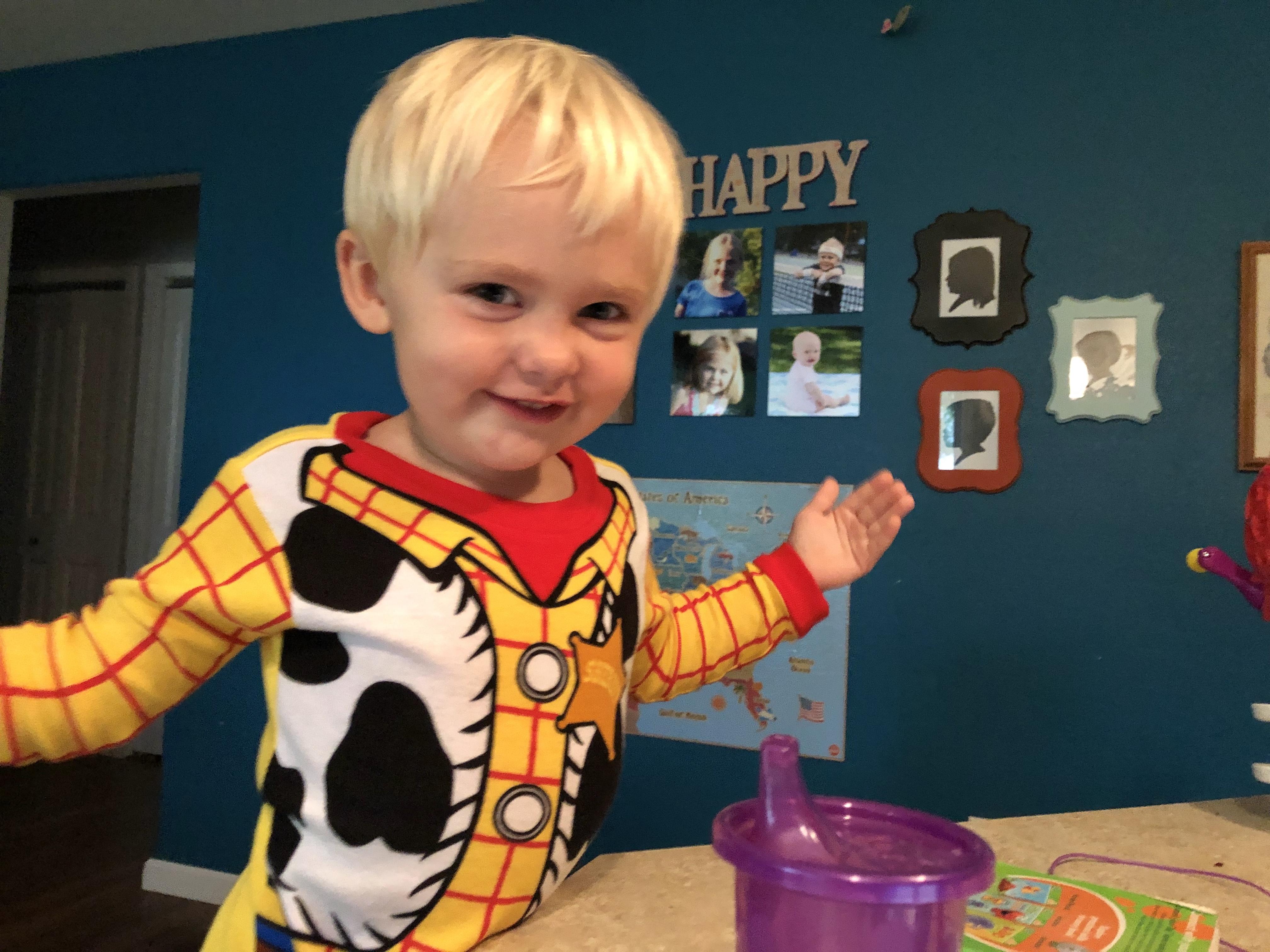 Toddler smiling at table