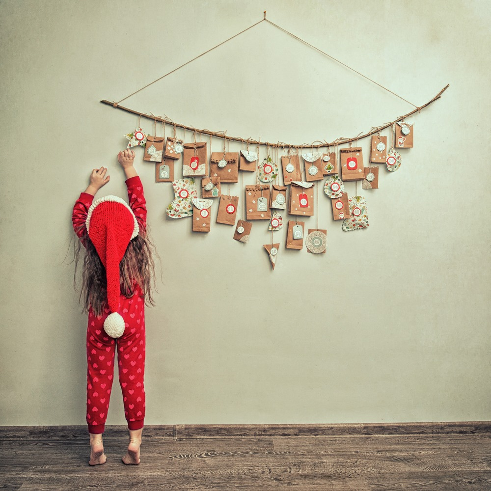Child hanging up advent calendar
