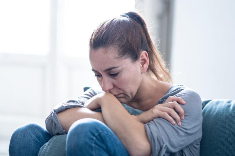 Sad woman hugging her knees