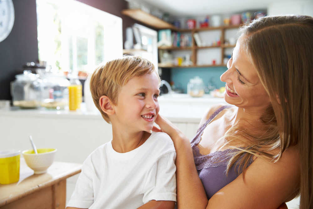 Mom and young son in kitchen