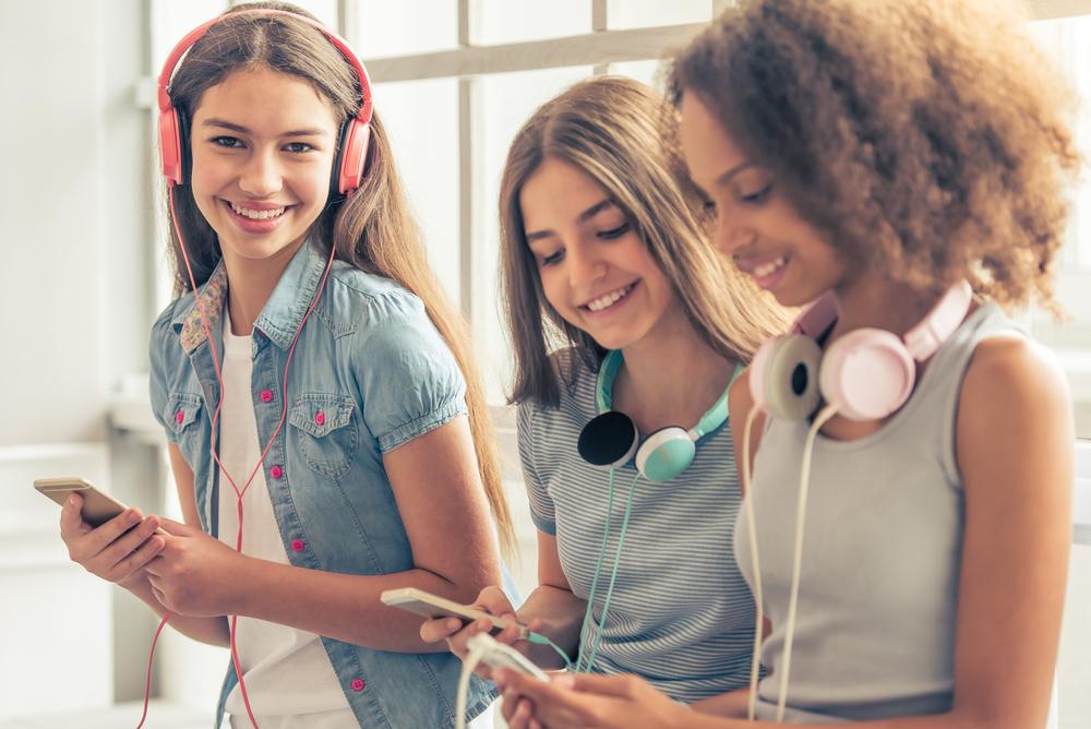 Tween and teen girls on phones