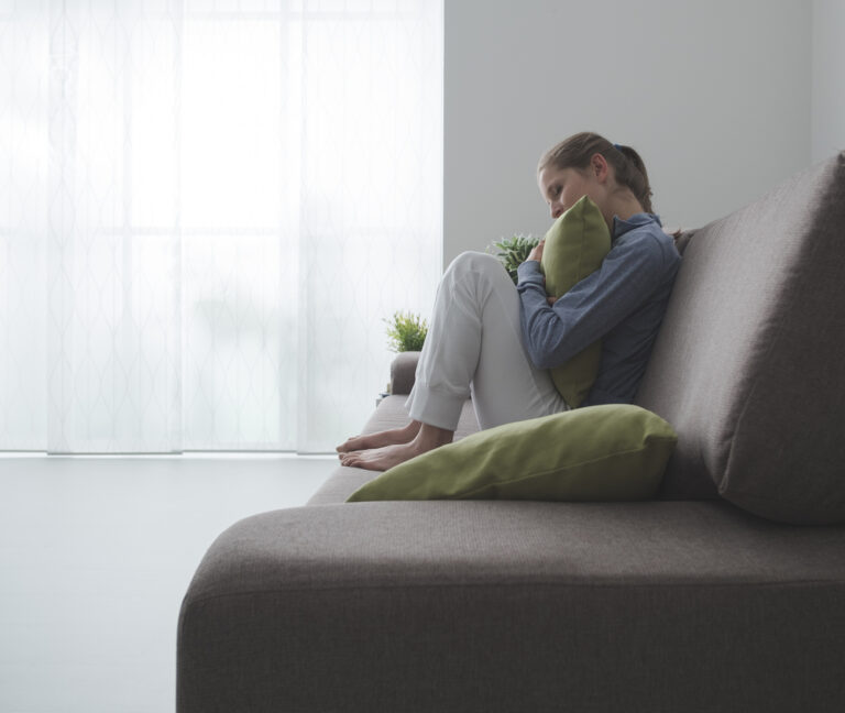 Sad woman on couch