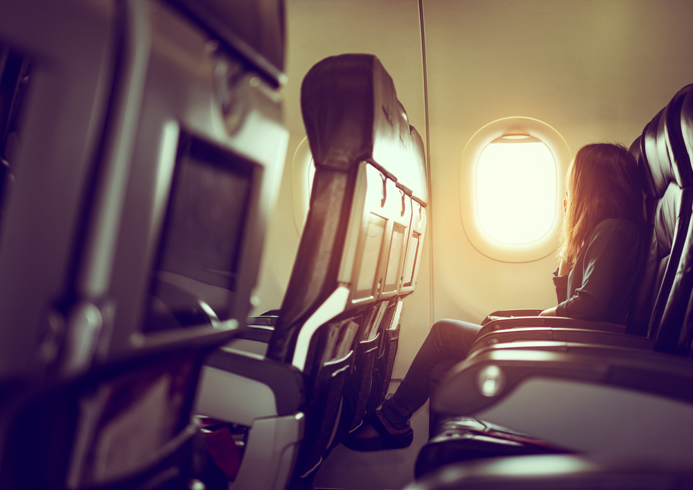 Woman looking out airline window