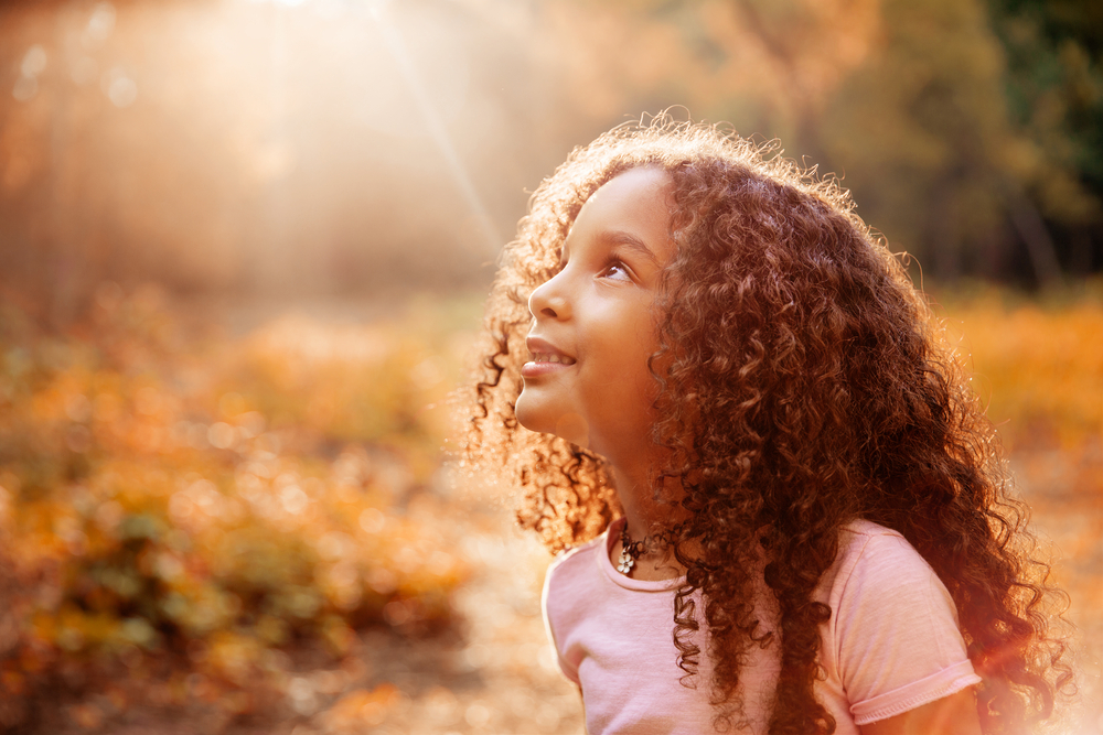 Child looking into sunlight