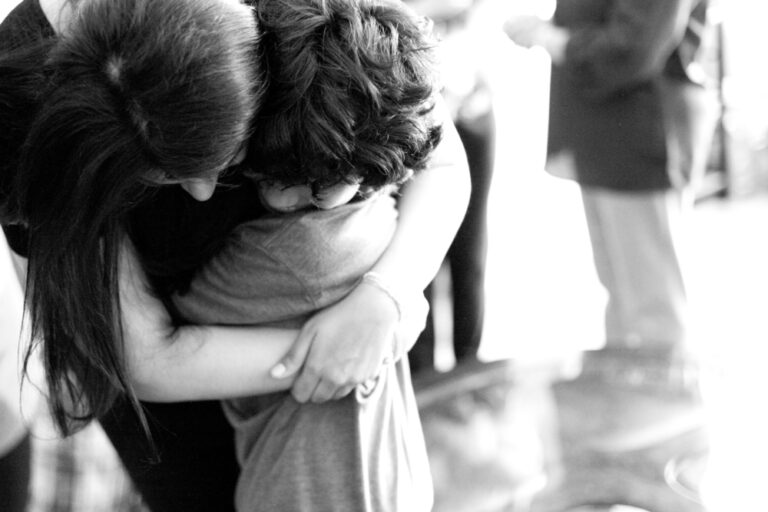 Mom and child hugging