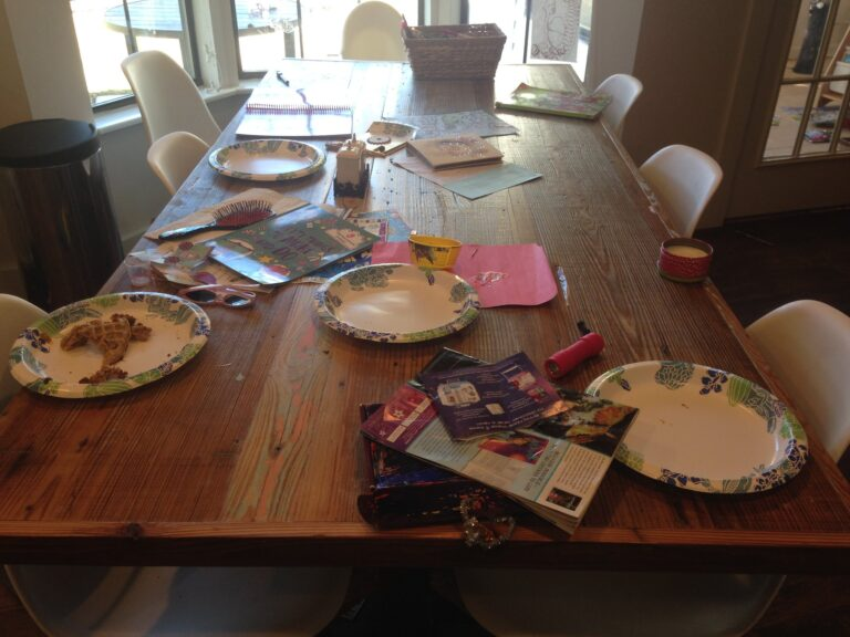 Table full of dirty dishes and clutter
