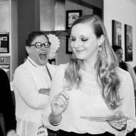 Woman laughing in the background of black and white photo