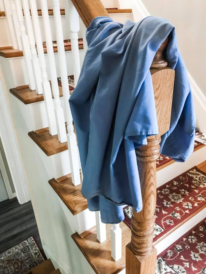 Blue scrubs on bannister