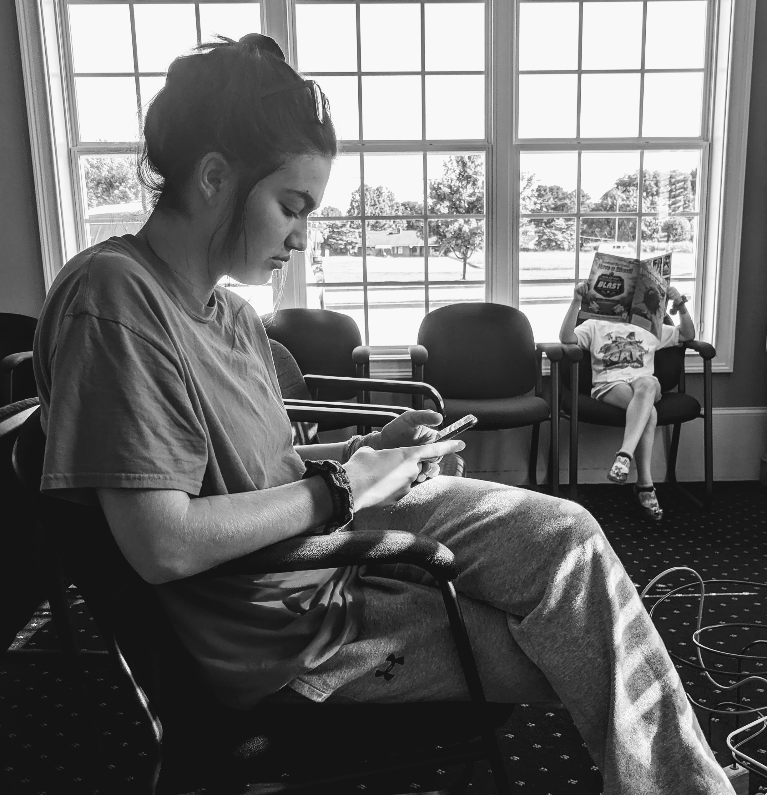 Teen sitting in chair