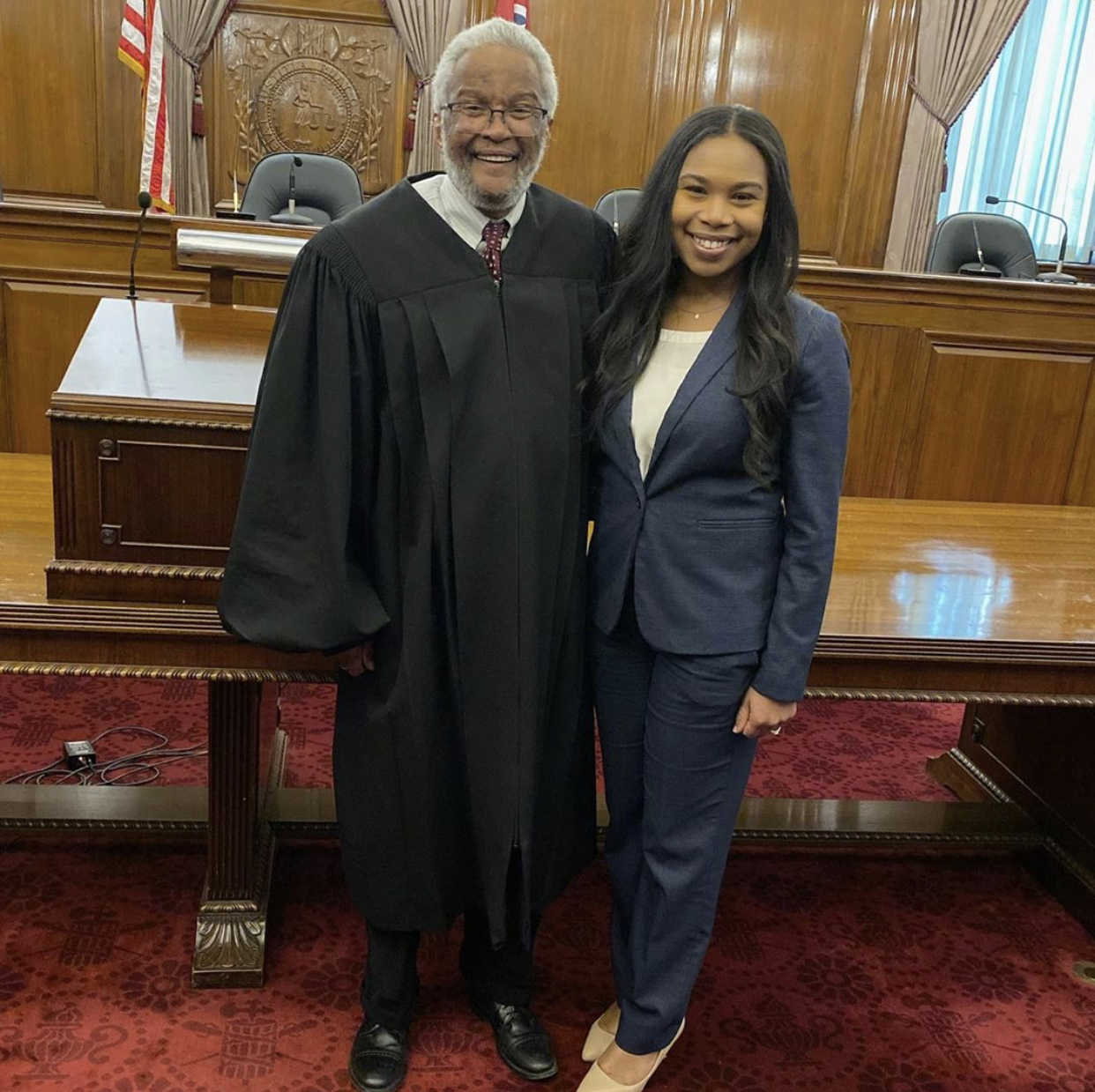 Judge holds baby during attorney admission ceremony.