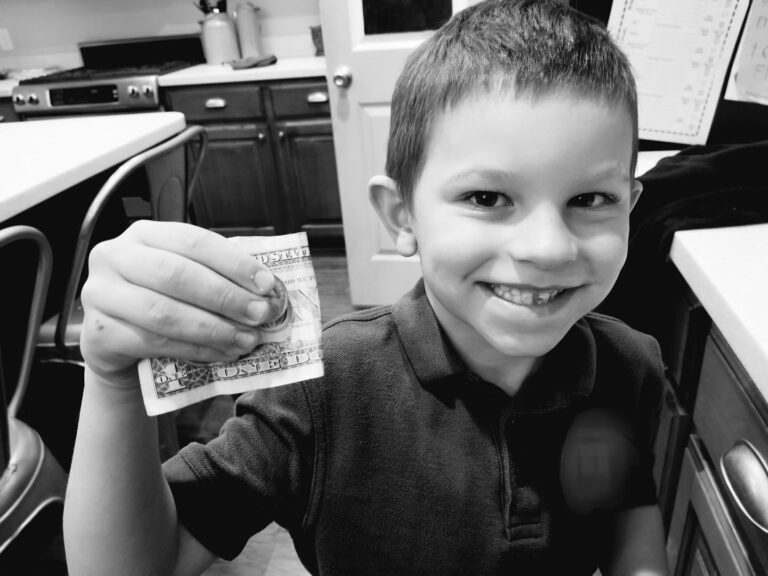 Black and white photo child with tooth fairy money