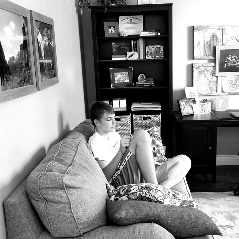 Teenage boy on couch with phone