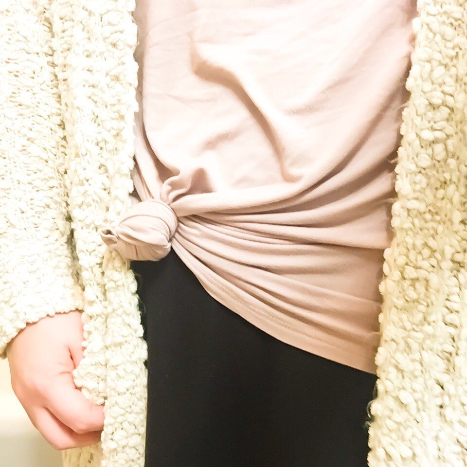Woman's knotted shirt and cardigan