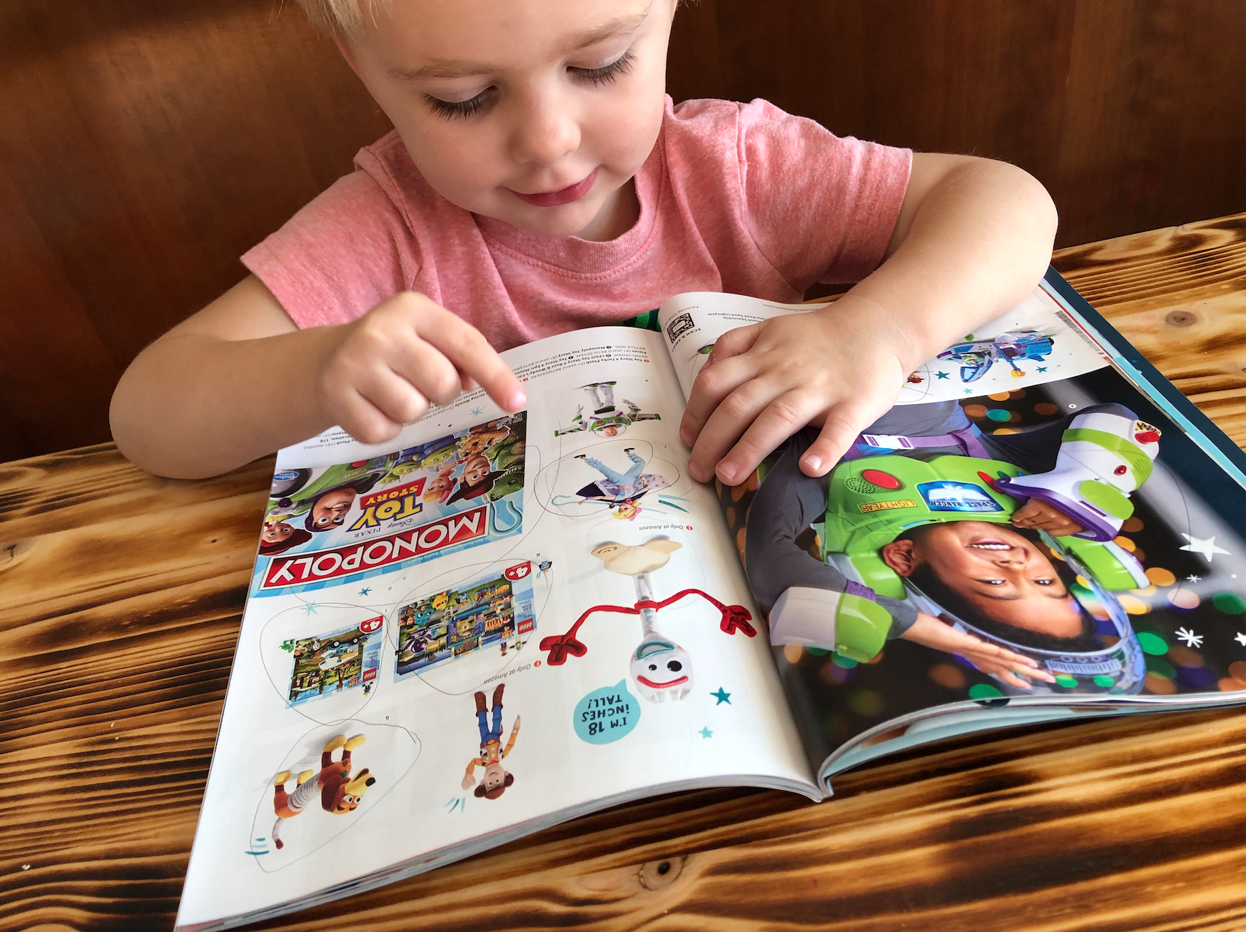 Amazon catalog child looking through pages