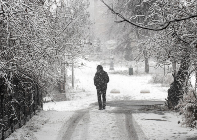 Man walking alone on snowy road