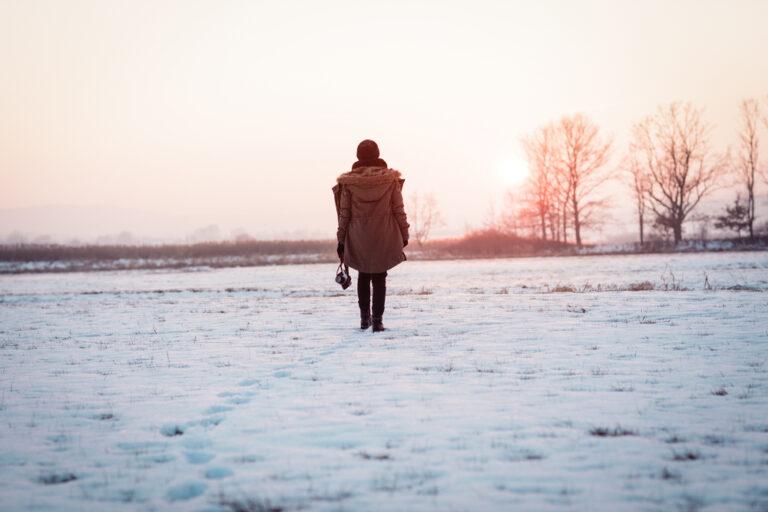 Sad woman walking alone