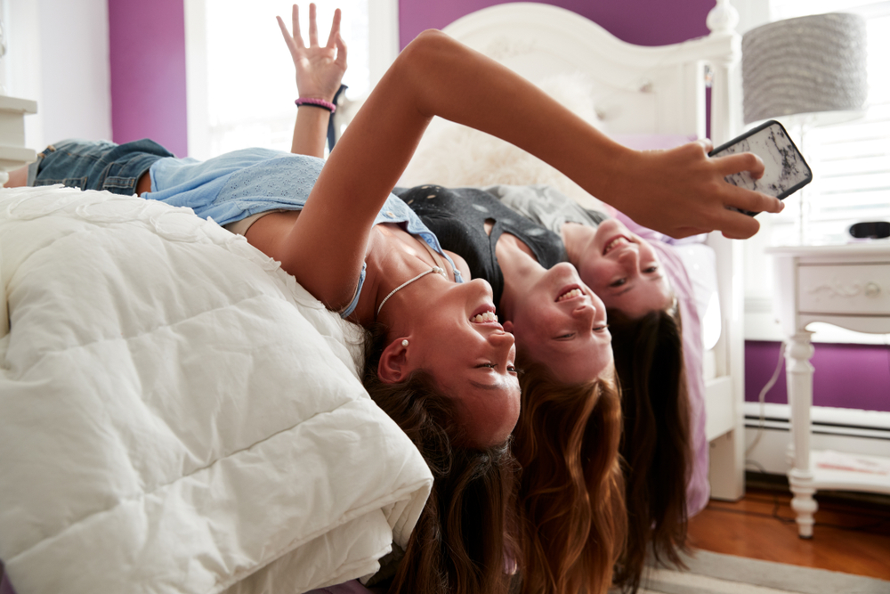 Teenage girls taking selfie