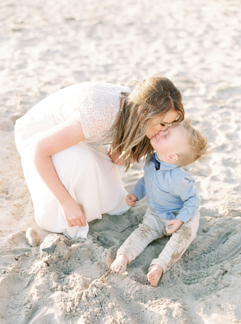 Little boy kissing his mom, color photo